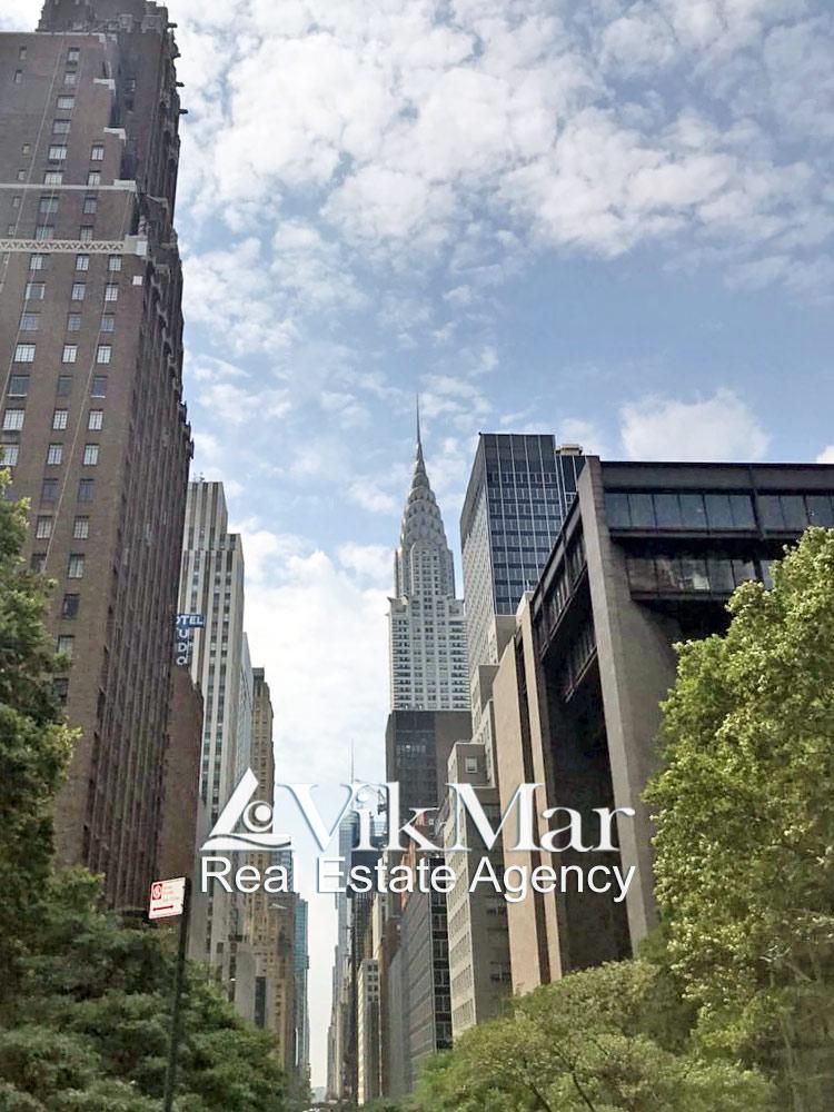 Вид на здания Крайслер Центра, Chrysler Building и Chrysler East Building в Нью Йорке